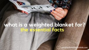 A person reading a magazine with a blanket over the legs, with overlaid text reading, 'What is a weighted blanket for? The essential facts.' Photo: Jacek Dyleg on Unsplash.com.