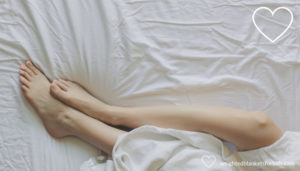 Legs exposed under a blanket. Photo credit: Matthew Henry via https://burst.shopify.com.