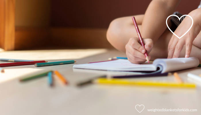 A child drawing. Photo credit: Sarah Jane on Pexels.