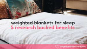 A bed with cushion overlaid with text reading 'weighted blankets for sleep: 5 research backed benefits'. Photo by Anna Sullivan on Unsplash.