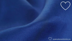 Blue cotton fabric weighted lap pad.