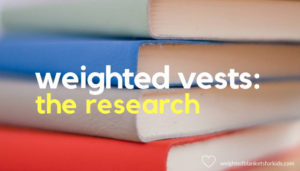 A pile of journals, overlaid with text' Weighted Vest Research'. Photo by Hope House Press - Leather Diary Studio on Unsplash.