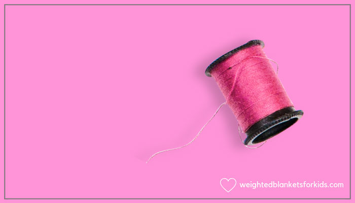 A pink cotton reel.
