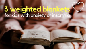 A child reading a book overlaid with text reading '3 weighted blankets for kids with anxiety'. Photo by Annie Spratt on Unsplash.