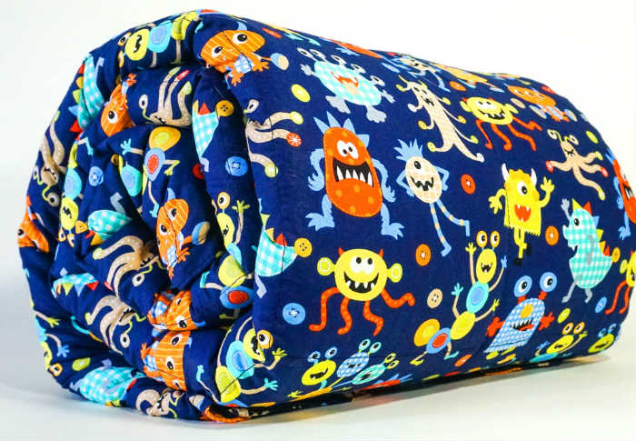 A Mosaic Weighted Blanket For Kids - Cotton Monsters Theme. Photo copyright: Mosaic Weighted Blankets.