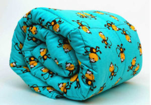 A Mosaic Weighted Blanket For Kids - Monkeys Theme. Photo copyright: Mosaic Weighted Blankets.