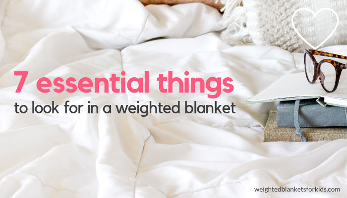 A white blanket overlaid with the text '7 essential things to look for in a weighted blanket'. Photo: Ivorymix.com